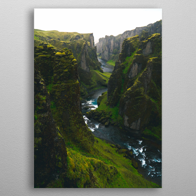 A bright green canyon with a river running through the middle. metal poster
