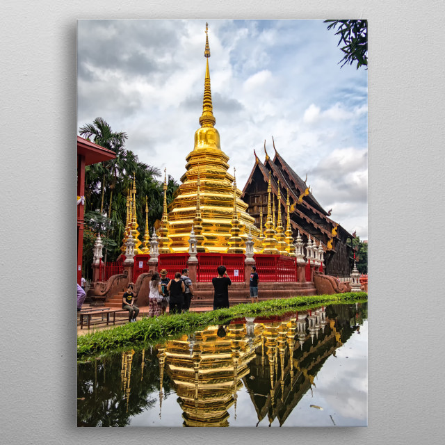 A temple's reflection on a small pond in Chiang Mai Thailand metal poster