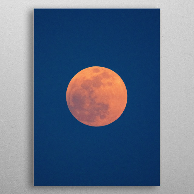 A bright orange full moon with a blue night sky backdrop. metal poster