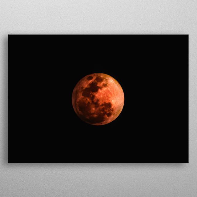 A total lunar eclipse. metal poster