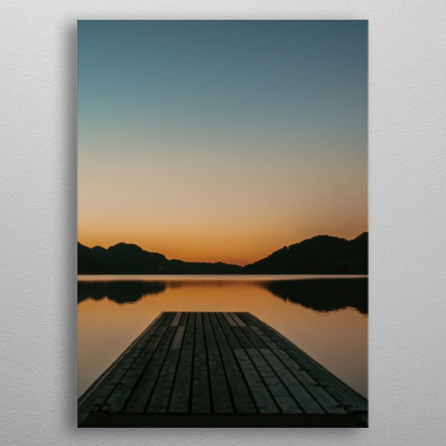 A shot of a tranquil sunset over a lake somewhere in Austria.  metal poster