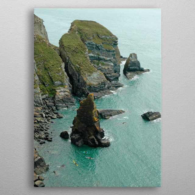 Canoes, or kayaks, paddling round the cliffs at South Stack near Holyhead on Anglesey, North Wales metal poster