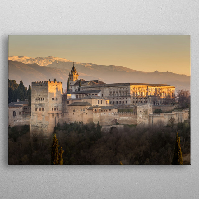 The beautiful Alhambra against the backdrop of the Sierra Nevada mountains at sunset.  metal poster