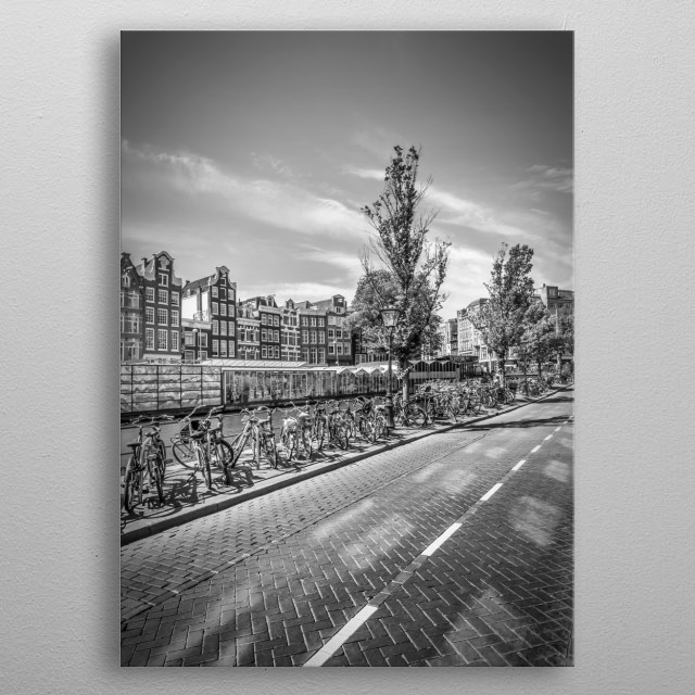 A typically cityscape with bicycles. The Bloemenmarkt next to Singel Canal is the world's only floating flower market. metal poster