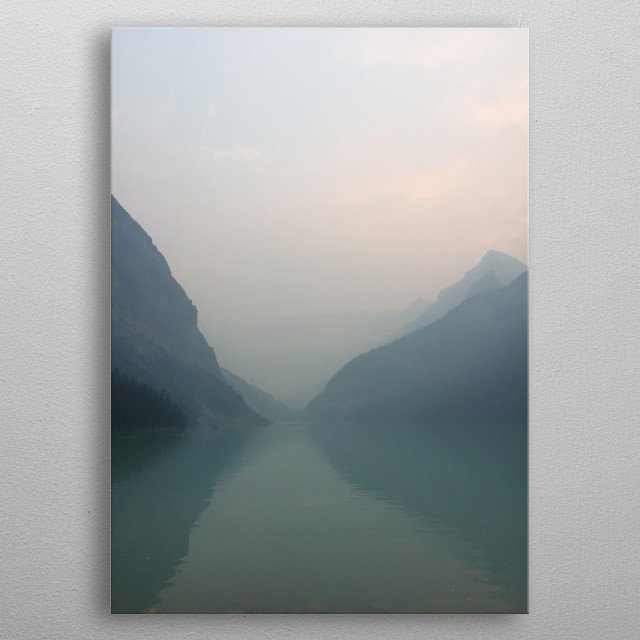 Photo of Lake Louise in the evening obscured by smoke. metal poster