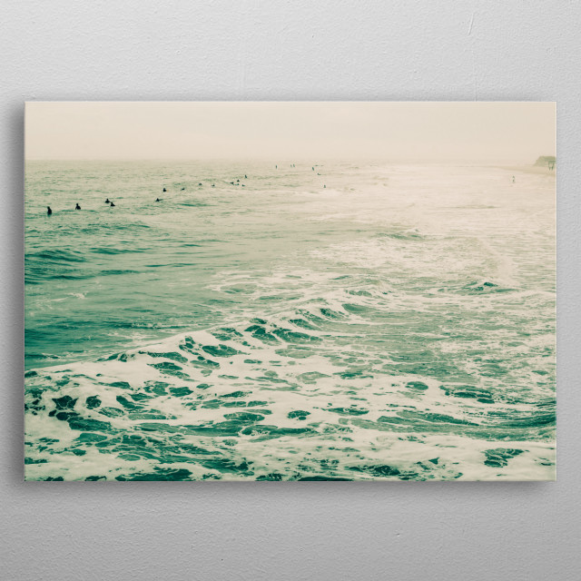Moody photograph by Olivia St.Claire of surfers floating in the sea. metal poster