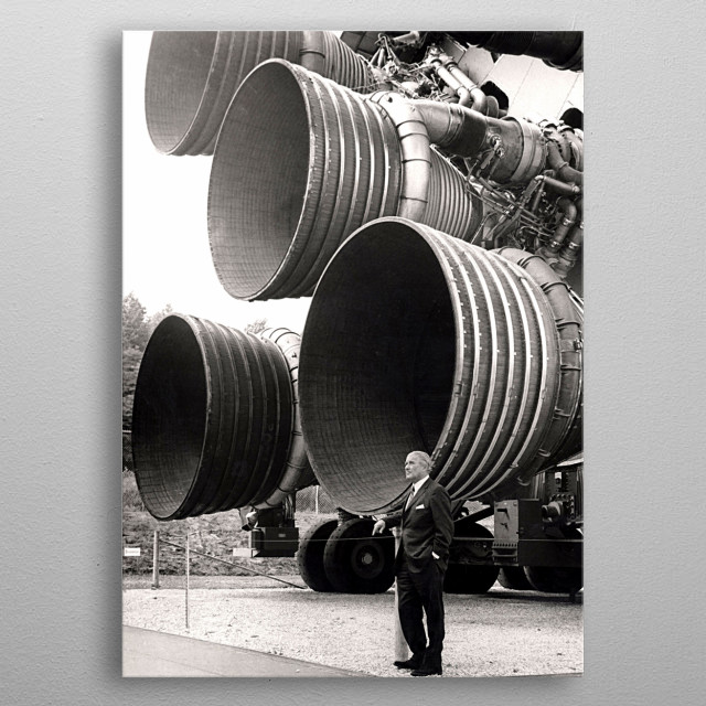A pioneer of America's space program, Dr. von Braun stands by the five F-1 engines of the Saturn V Dynamic Test Vehicle. metal poster
