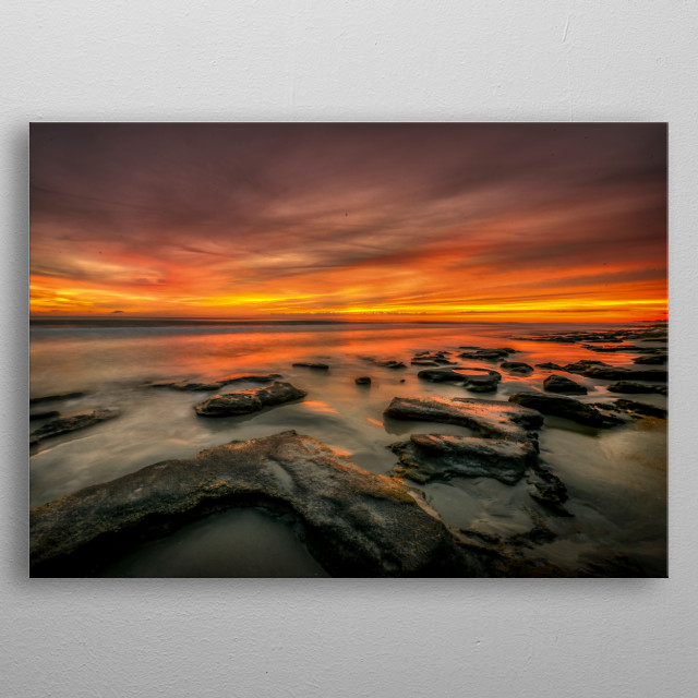 Ten minutes before the sun shows itself above the horizon, a burst of orange and reds paint the sky with these brilliant colors.  metal poster