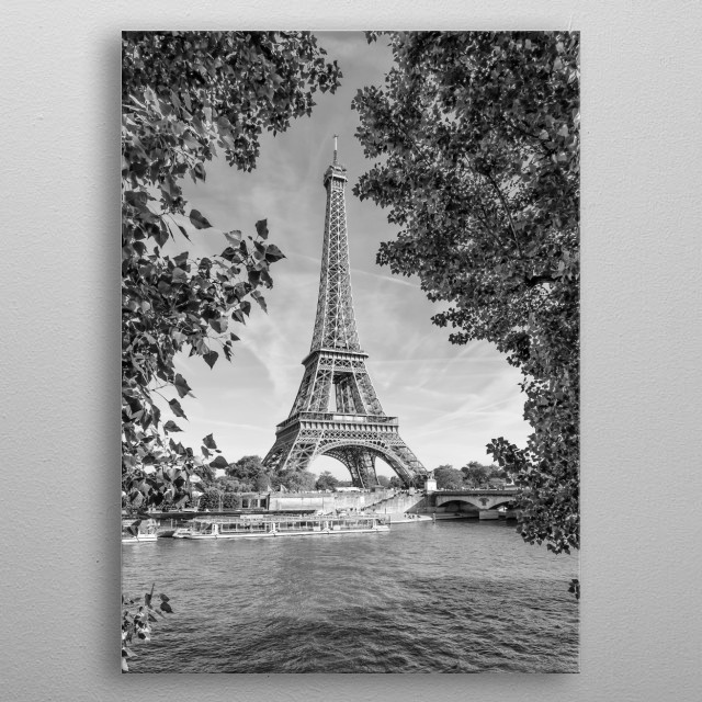 Classical monochrome impression from Paris. The Eiffel Tower is picturesquely framed by trees. metal poster