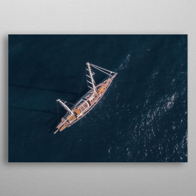 Top view of a yatch boat sailing in open ocean metal poster