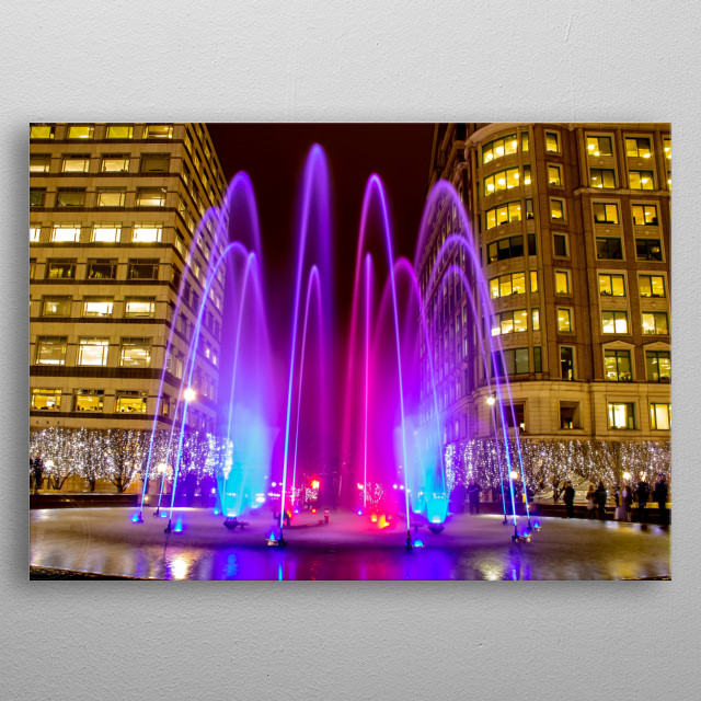 Long exposure shot of the Cabot Square Fountain during the 2019 Winter Lights display in Canary Wharf, London.  metal poster