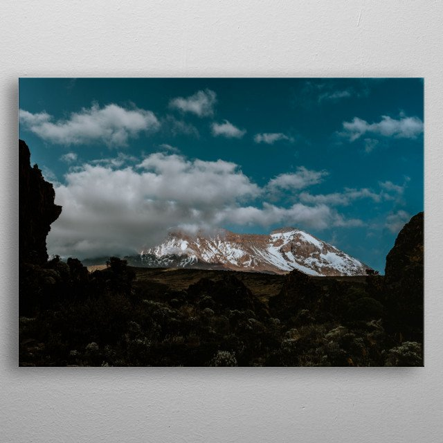 At 3,850m above sea level, Kilimanjaro glows in the late afternoon light. Tanzania, Africa. ©2019 Valerie Rosen metal poster