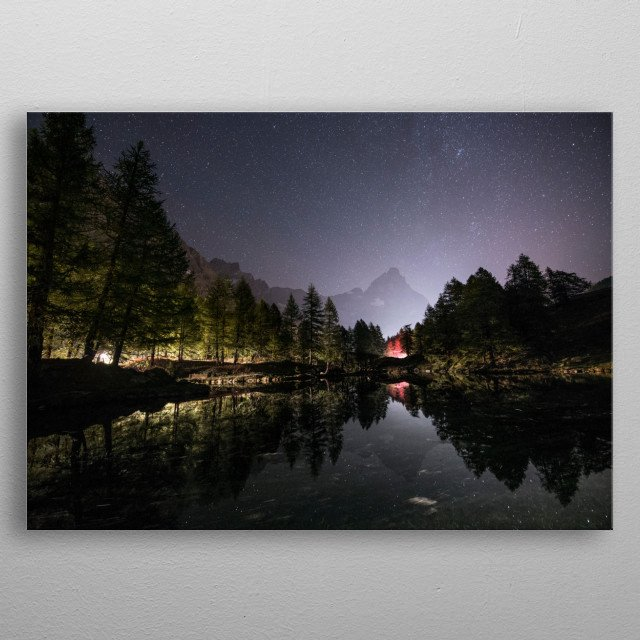 Night view of Matterhorn mountain, Alps, Italy. The beautiful sky full of stars surrounding the peak reflects into a mountain lake. metal poster