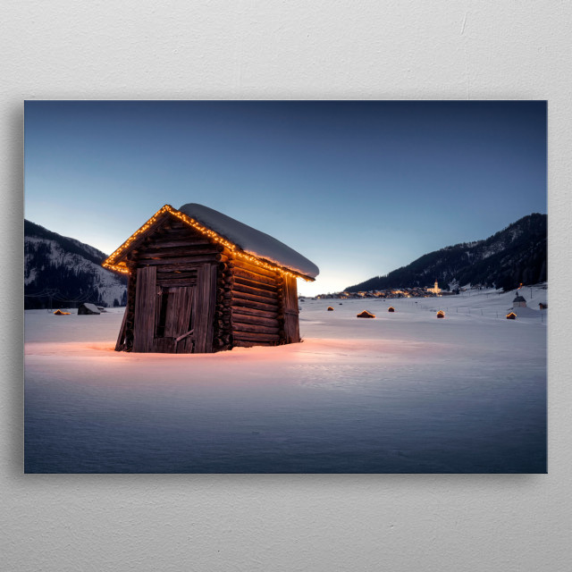 A small village in the last light of a cold winter evening in the alps. With illuminated cabins here and there. metal poster