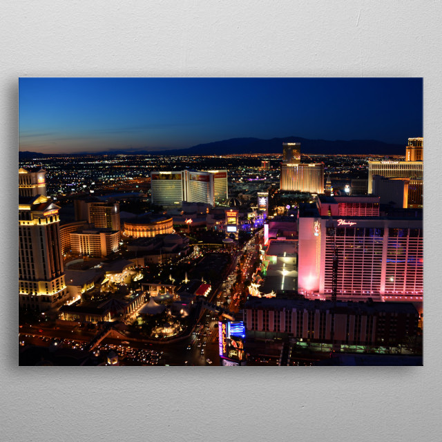 Night photography of the northern part of Las Vegas Boulevard looking towards downtown.  metal poster