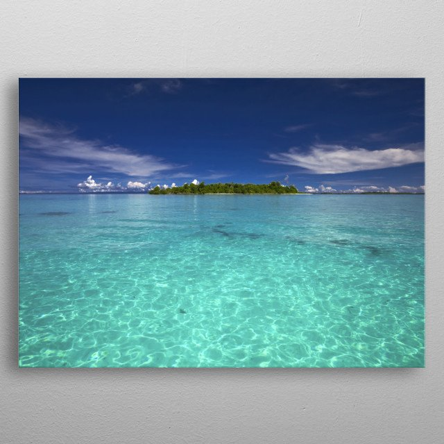 A deserted paradise island surrounded by crystal clear waters and blue skies. metal poster