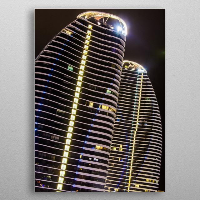 The lights of the hotel twin towers are quite impressive at night time. metal poster