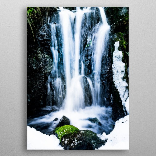 The snow is melting away and creates small waterfalls as the green moss and grass once again resurface. metal poster