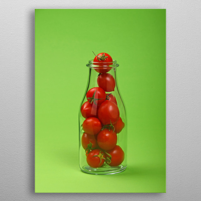 Red cherry tomatoes in glass bottle on green background metal poster
