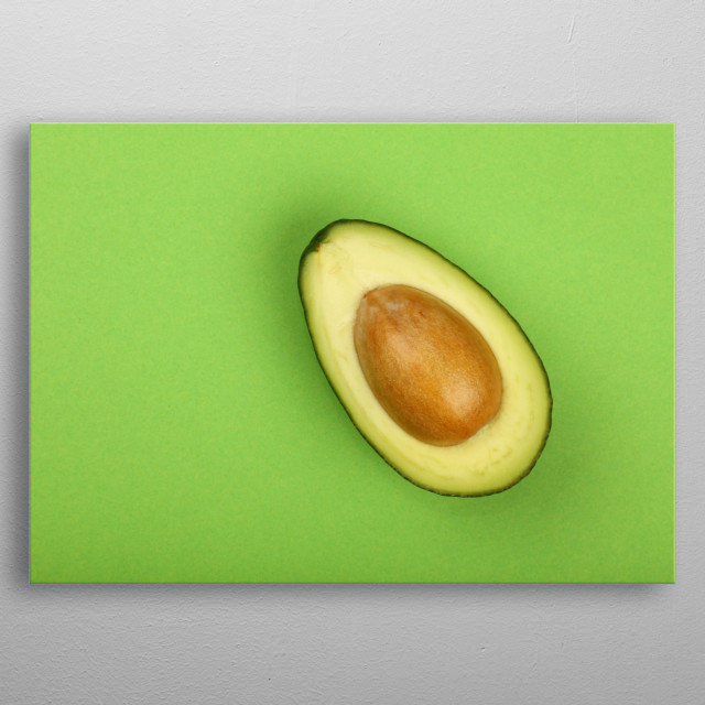 Close up cut halved avocado on green background metal poster