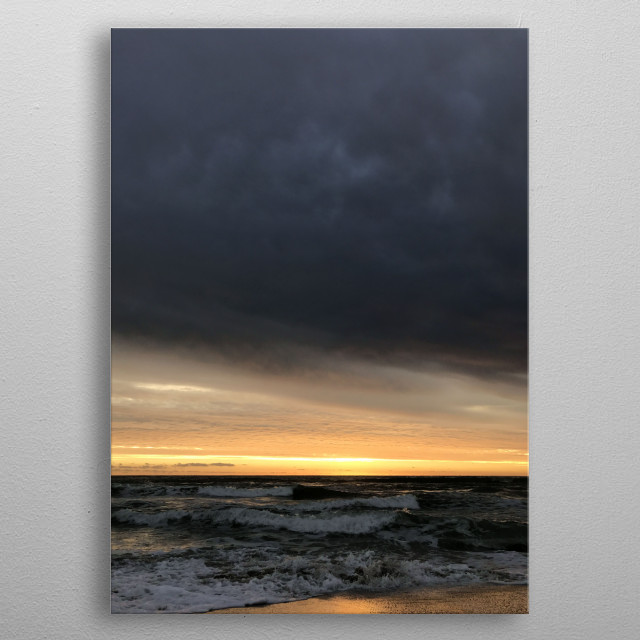 Beautiful dark sky, golden dawn light, cold water. The storm is coming.  metal poster