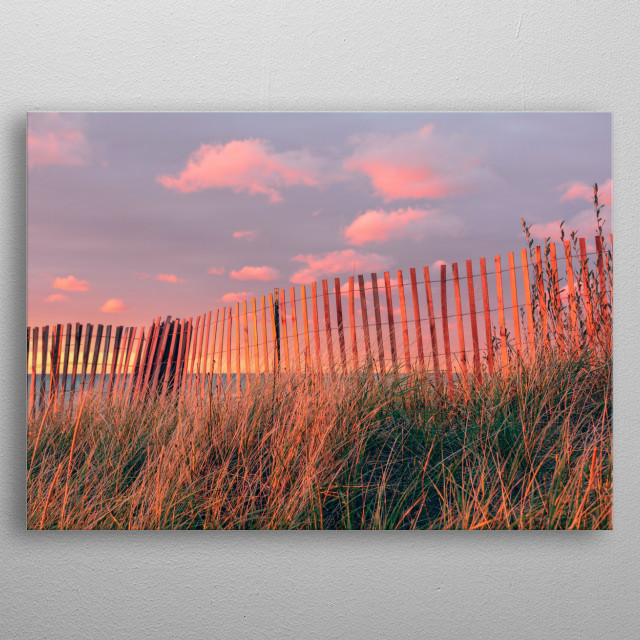 Photograph of a fence in beach dunes at sunset. metal poster