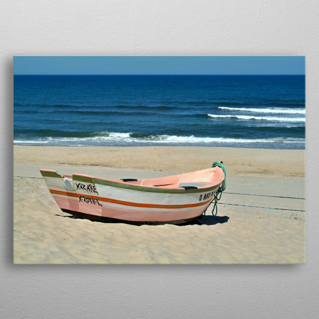 A traditional colorful fishing boat on the beach at Portugals west coast metal poster
