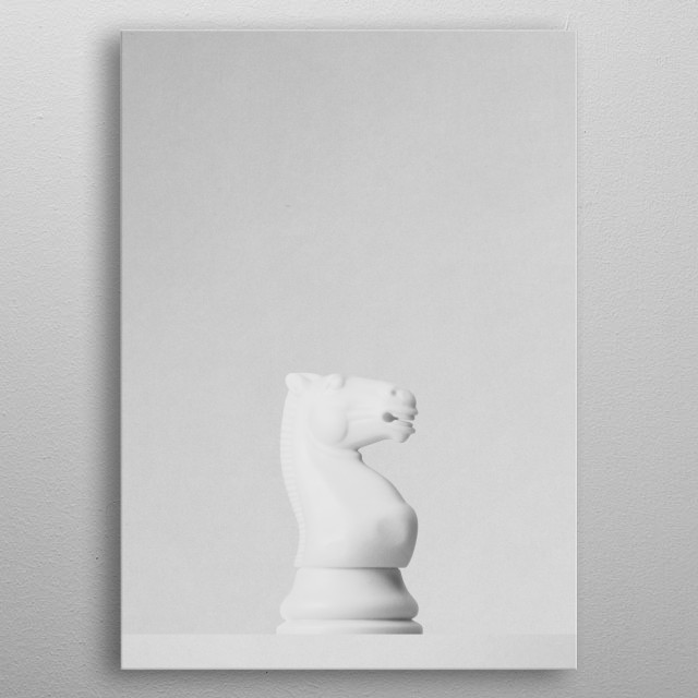 A white knight a chess game in front of a white background. Part of a series of minimalist photographs of chess pieces. metal poster