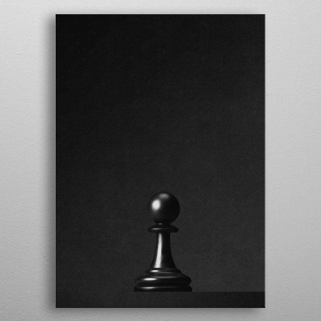 A black pawn a chess game in front of a black background. Part of a series of minimalist photographs of chess pieces. metal poster