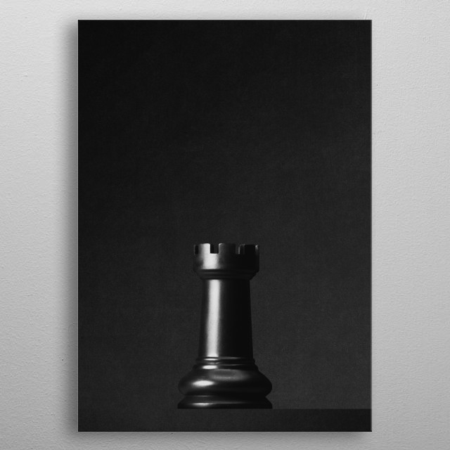 A black rook a chess game in front of a black background. Part of a series of minimalist photographs of chess pieces. metal poster