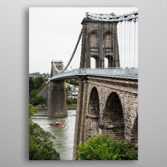 Menai Bridge is a suspension bridge spanning the Menai Strait from Bangor, Wales, to the island of Anglesey. metal poster