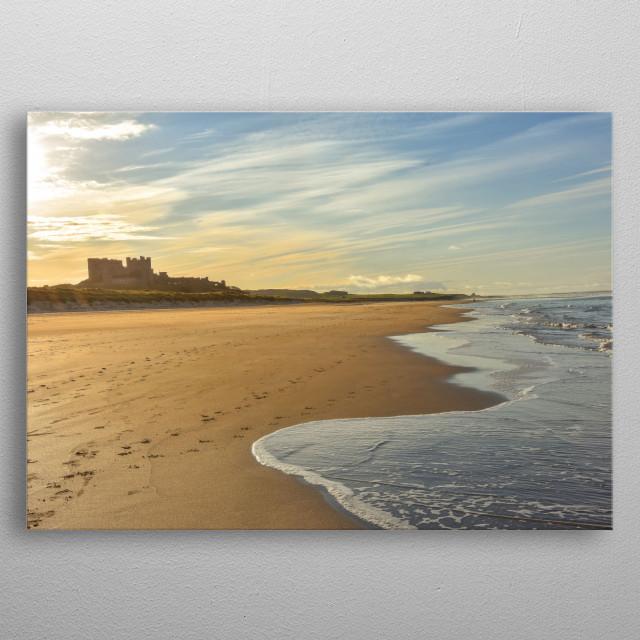 Sunset at Bamburgh Castle on the northeast coast of England. Northumberland coast. metal poster