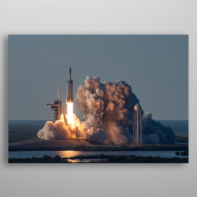 Falcon Heavy is a partially reusable heavy-lift launch vehicle designed and manufactured by SpaceX. metal poster