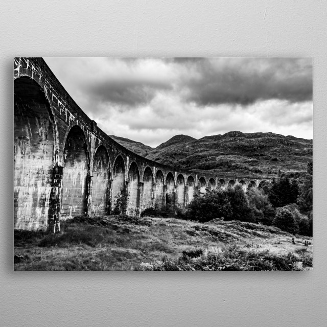 Black and White photo of the railroad from Harry Potter located in Scotland. The picture was taken under it, capturing the arches properly. metal poster