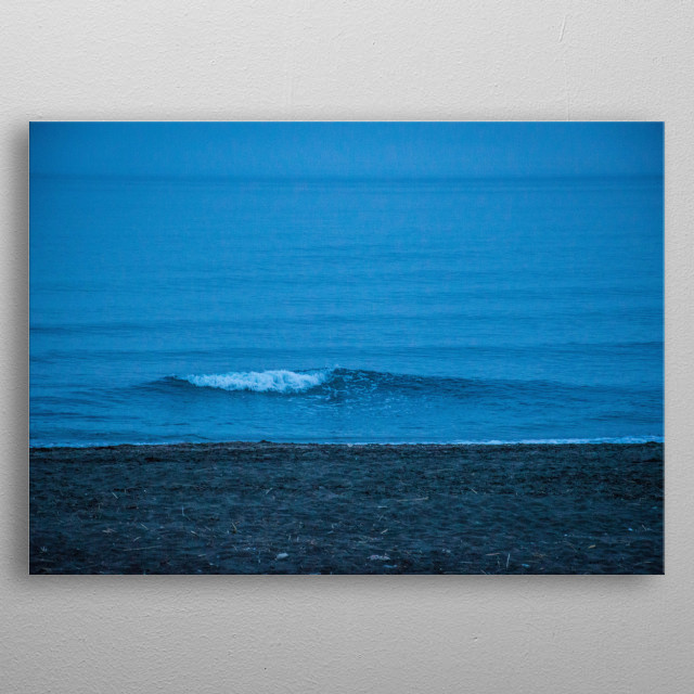 A lonely wave, slowly drifting towards the shore. The photo captures perfectly the essence of nostalgia thanks to its colours. metal poster