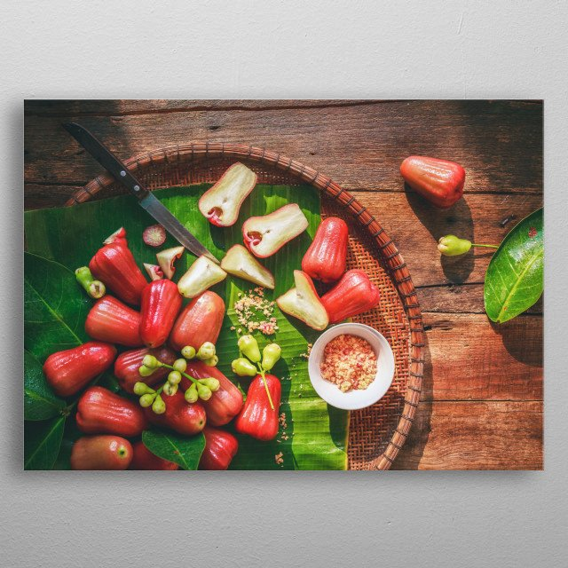 Mountain apple fruits on the old wood background metal poster