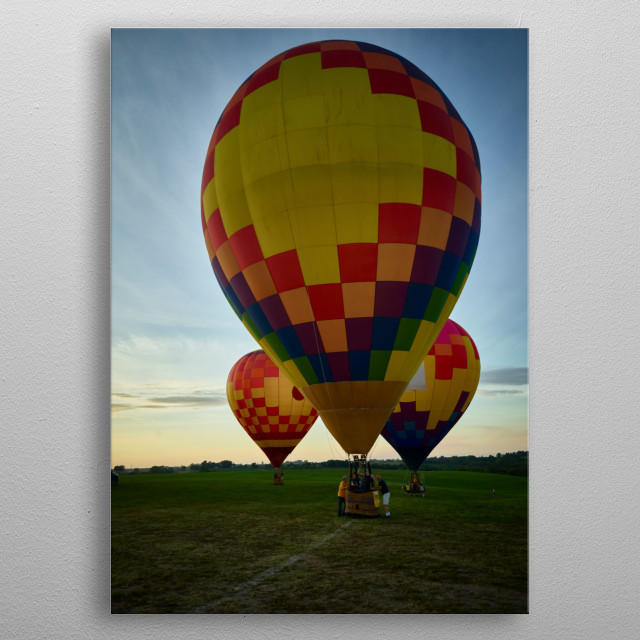 As dusk approaches, balloons land at the National Balloon Classic, a hot air balloon exhibition in Indianola, Iowa, a town near the state ca metal poster