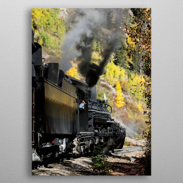 Scenic Railroad train, pulled by a vintage steam locomotive, chugs through the San Juan Mountains in the Colorado county of the same name  metal poster