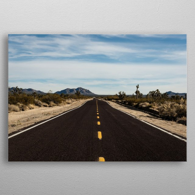 A very long and very brown road in the Mojave National Preserve in California  metal poster