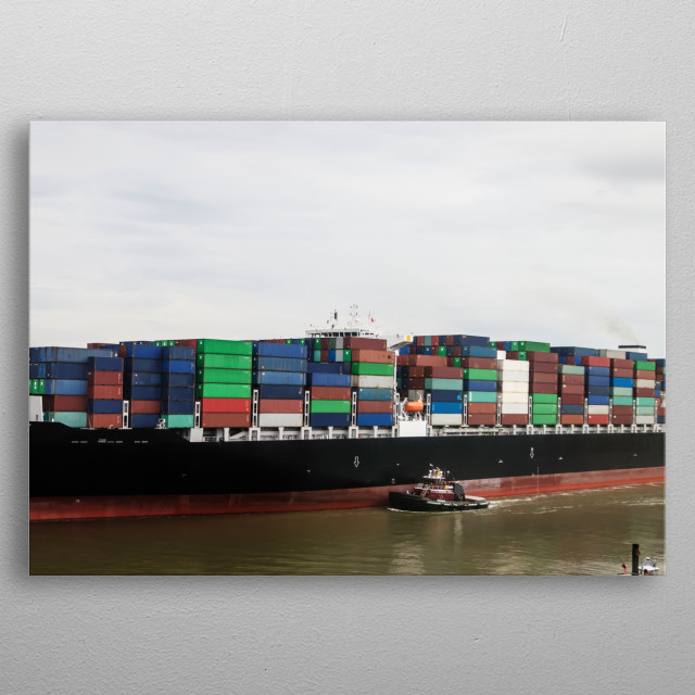 With a tugboat's help, an exceptionally heavy-laden oceangoing container ship plies the busy Savannah River in Savannah, Georgia  metal poster