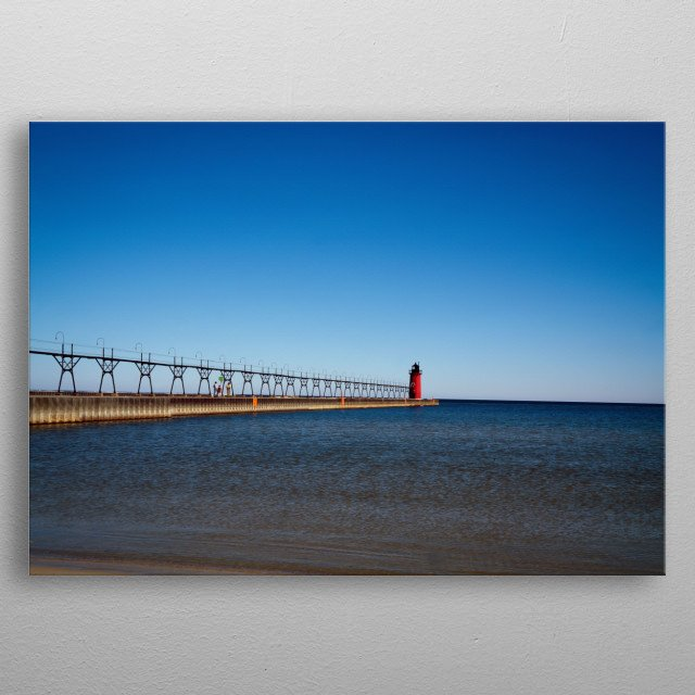 The South Haven South Pierhead Light is a lighthouse in Michigan, at the entrance to the Black River on Lake Michigan  metal poster