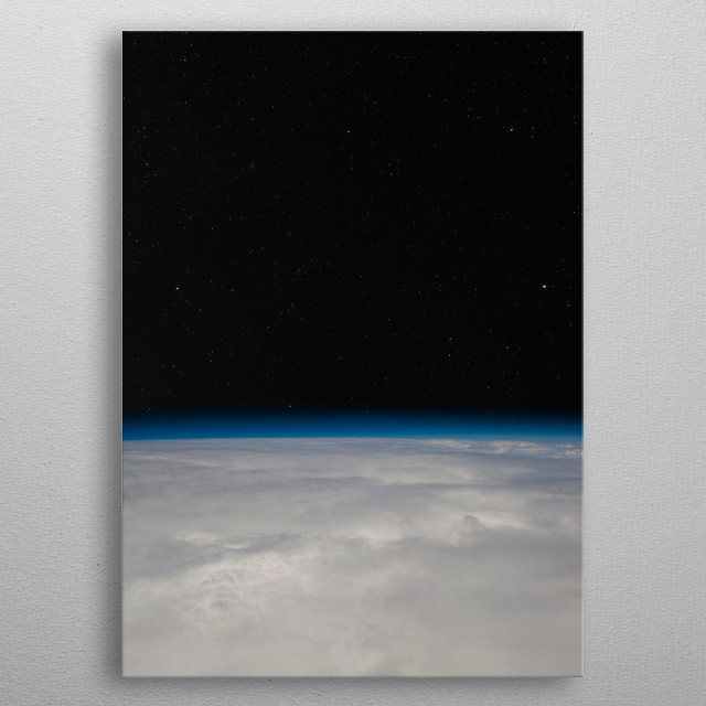 A view of the night sky from above the clouds. metal poster