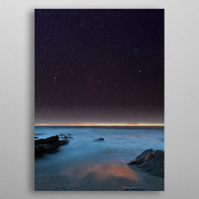 The rocky Cornish coastline after sunset. metal poster