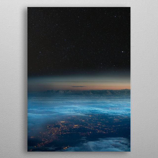 The stars of the night sky contrast with the artificial lights of the city. View from an airliner. metal poster