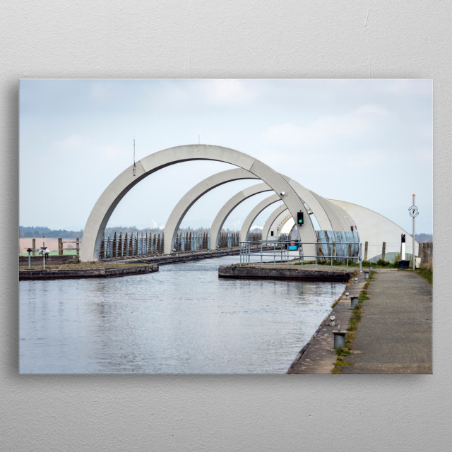 The Falkirk Wheel is a rotating boat lift in central Scotland, connecting the Forth and Clyde Canal with the Union Canal. metal poster