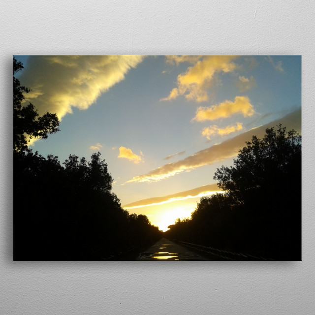 Photo of a sunset sky after the rain. metal poster