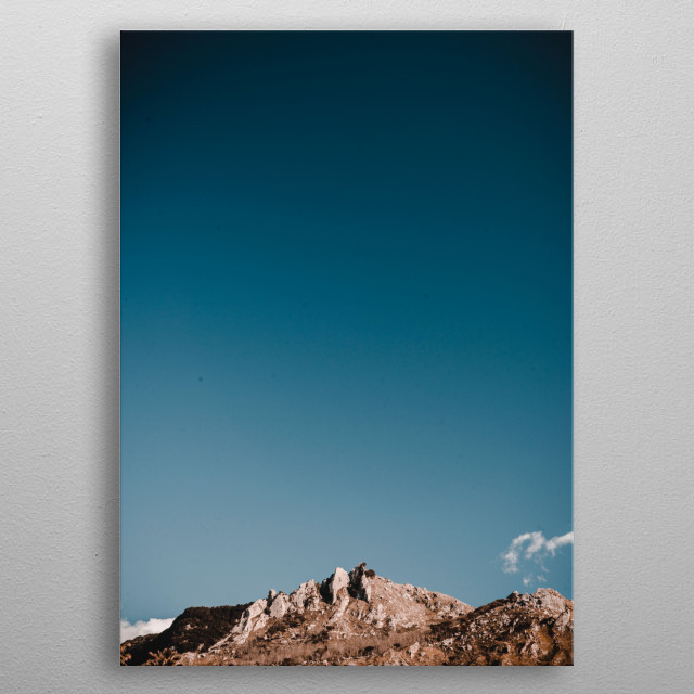 A cloudless sky over a mountainous landscape.  metal poster