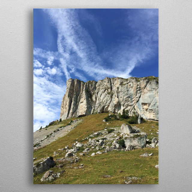 Some landscapes are extraordinary, such as this mountain and its impressive cliffs, cutting through the blue sky and the clouds. metal poster