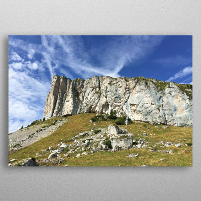 Some landscapes are extraordinary, such as this mountain and its impressive cliffs, cutting through the blue sky and the clouds, metal poster