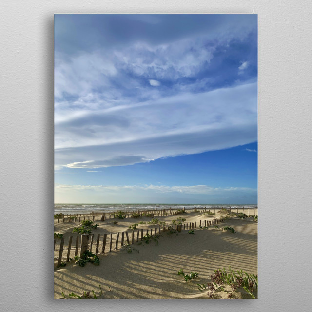 The sun rose more than an hour ago, the weather is fine, the wind is blowing, we can see pretty little waves on the sea. metal poster